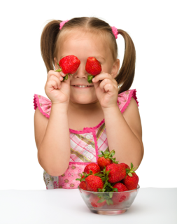 little girl with strawberries