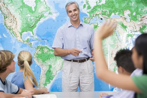 Teacher in front of world map